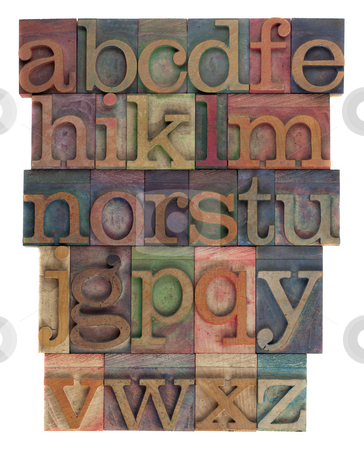 Alphabet abstract - vintage wooden letterpress type stock photo, English alphabet (lower case) in vintage wooden letterpress type, stained by  inks of different colors, flipped horizontally, isolated on white by Marek Uliasz