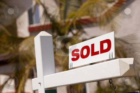 Close-up of Sold Real Estate Sign stock photo, Close-up of Sold Real Estate Sign in Front of House. by Andy Dean