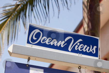 Ocean Views Real Estate Sign stock photo, Ocean Views Real Estate Sign in Front of House. by Andy Dean