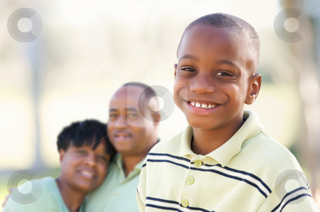 Handsome African American Boy with Parents stock photo, Handsome African American Boy with Proud Parents Standing By in the Park. by Andy Dean