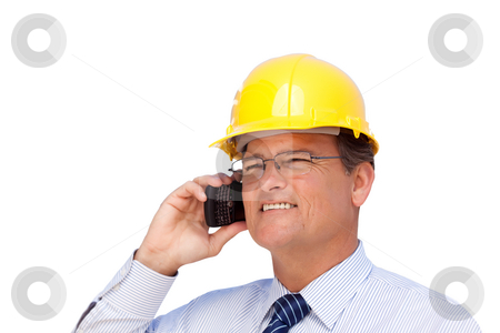 Contractor in Hardhat on His Cell Phone Isoalted stock photo, Handsome Contractor in Hardhat and Necktie Smiles as He Talks on His Cell Phone Isolated on a White Background. by Andy Dean