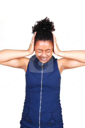 Young woman in noisy place. stock photo, A young Hispanic girl standing in a very noisy place and covering her ears with her hands, in a blue dress with a zipper in front, for white background. by Horst Petzold