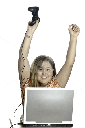 Video Game Winner stock photo, A young girl cheering because she is winning at a video game, isolated against a white background. by Richard Nelson