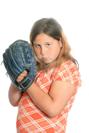 Playing Catch stock photo, A preteen girl wearing casual clothing is playing catch with a ball and mitt, isolated against a white background. by Richard Nelson