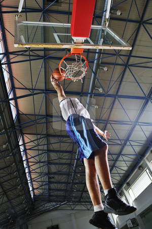 Basketball jump stock photo, Young healthy man play basketball game indoor in gym by Benis Arapovic