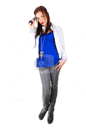 Girl with white jacket, smiling. stock photo, A young smiling woman in a light gray leather jacket with her hand on her head in gray jeans, standing for white background. by Horst Petzold