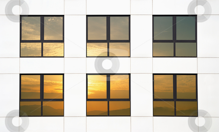Sunset office stock photo, Six windows in a white office reflecting the sunset by Paul Phillips