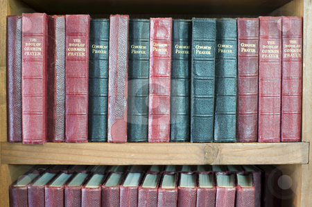 Prayer books stock photo, Book shelf with rows of leather bound prayer books by Stephen Gibson