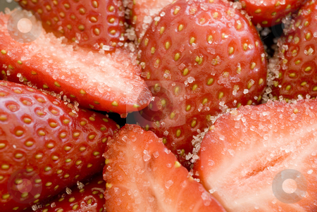 Sugar strawberries stock photo, Close up on some sliced strawberries covered in white sugar granules by Stephen Gibson