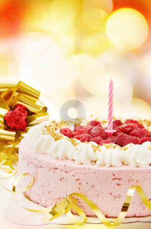 Birthday raspberry cake stock photo, Celebrating a special day with delicious raspberry cake over defocused lights. by Andreea Chiper