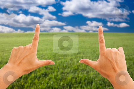 Female Hands Making a Frame Over Grass and Sky stock photo, Female Hands Making a Frame Over Grass Field and Sky. by Andy Dean