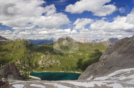 Panorama from Marmolada glacier stock photo, Summer view of Fedaia lake and dolomites from Marmolada glacier, Trentino, Italy. Photo taken with polarizer filter by ANTONIO SCARPI
