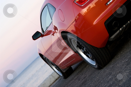 Modern Sports Car stock photo, A modern sports car parked at the beach around sunset. by Todd Arena