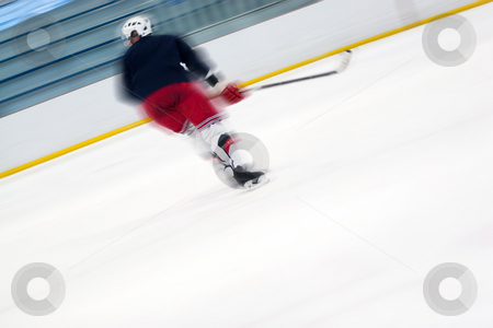 Hockey Player Abtract stock photo, Abstract motion blur of a hockey player as he skates down the ice. Slight motion blur and shallow depth of field. by Todd Arena