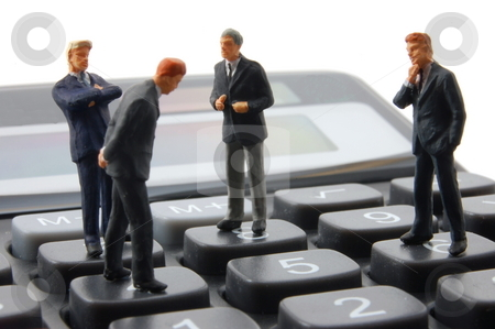 Toy business man on calculator isolated  stock photo, Toy business man on calculator isolated on white background by Gunnar Pippel