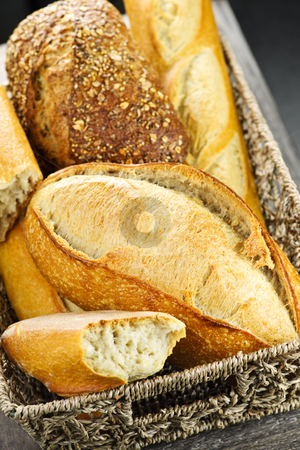 Bread in basket stock photo, Various kinds of fresh baked bread in basket by Elena Elisseeva