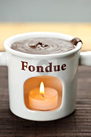 Chocolate fondue pot stock photo, Delicious melted chocolate in ceramic fondue pot by Elena Elisseeva