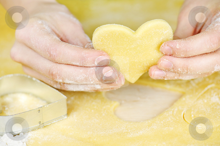 Making shortbread cookies stock photo, Making heart shaped shortbread cookies with cutters by Elena Elisseeva