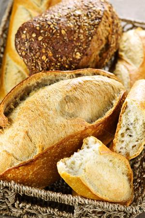 Bread in basket stock photo, Various kinds of fresh baked bread in basket by Elena Elisseeva