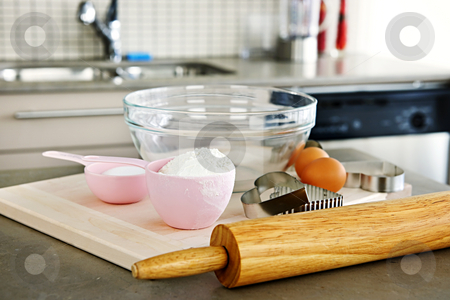 Baking cookies stock photo, Cookie baking utensils and ingredients in kitchen at home by Elena Elisseeva