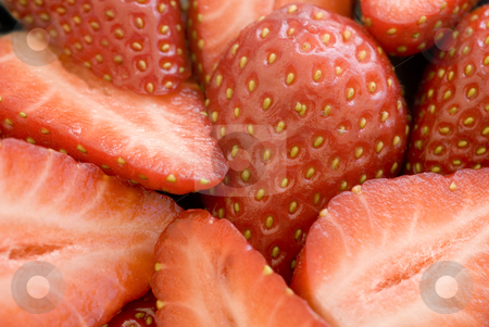 Sliced strawberries stock photo, Close up on some sliced ripe strawberries by Stephen Gibson