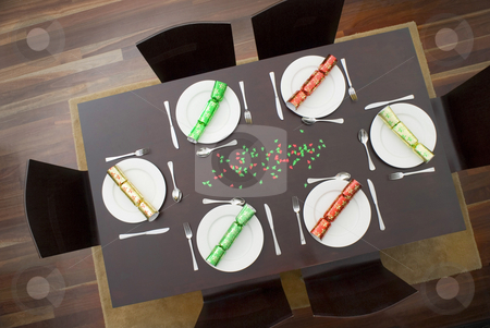 Christmas dinner table stock photo, Looking down on a modern table set up for a christmas dinner by Stephen Gibson