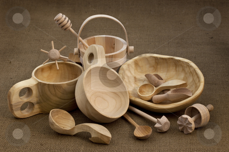 Folk wood craft from Poland stock photo, Polish folk wood craft (cups, bowl, spoons, scoops, bucket, kitchen utensils, butter mold, honey drizzler) on burlap background by Marek Uliasz