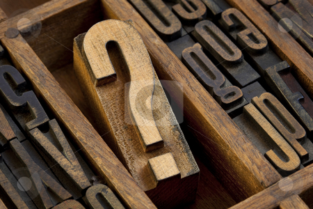 Question mark in vintage letterpress type stock photo, Question mark - vintage wooden letterpress type block in old typesetter drawer among other letters stained by ink by Marek Uliasz