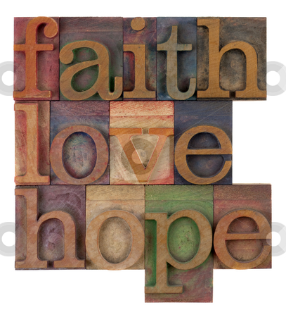 Faith, love and hope stock photo, Biblical, spiritual  or methaphysical reminder - faith, hope and love in old wooden letterpress type blocks, stained by colorful inks, isolated on white by Marek Uliasz