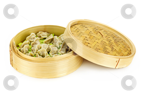 Bamboo steamer with dumplings stock photo, Bamboo steamer with cooked dumplings isolated on white by Elena Elisseeva