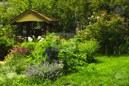 Landscaped garden stock photo, Lush green landscaped garden with flowers and gazebo by Elena Elisseeva