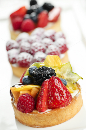 Fruit tarts stock photo, Closeup of fancy gourmet fresh fruit dessert tarts by Elena Elisseeva