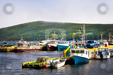 Fishing boats in Newfoundland stock photo, Harbor with various fishing boats in Newfoundland Canada by Elena Elisseeva
