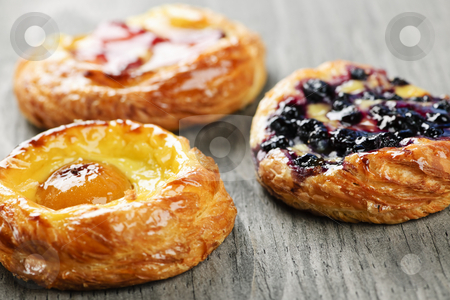 Fruit danishes stock photo, Closeup on three sweet fruit danish desserts by Elena Elisseeva