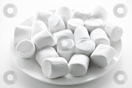 Marshmallows on plate stock photo, Close up of many plump sweet marshmallows on plate by Elena Elisseeva