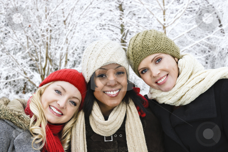 Group of girl friends outside in winter stock photo, Group of three diverse young girl friends outdoors in winter by Elena Elisseeva