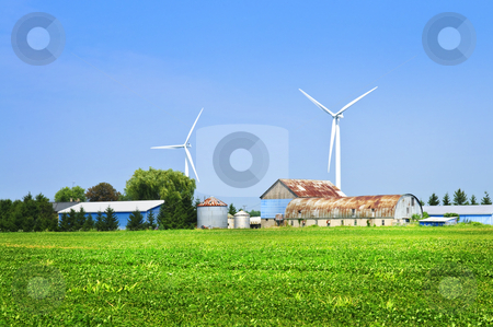 Wind turbines on farm stock photo, Green alternative clean power wind turbines on farm by Elena Elisseeva