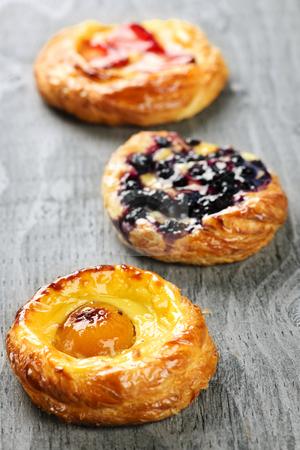 Fruit danishes stock photo, Closeup on three sweet fruit danish desserts by Elena Elisseeva
