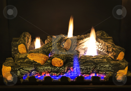Gas fireplace stock photo, Close up of logs in gas fireplace by Elena Elisseeva