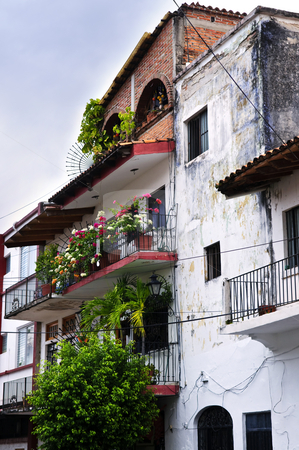 Old building in Puerto Vallarta, Mexico stock photo, Balconies with flower boxes on old building in Puerto Vallarta, Jalisco, Mexico by Elena Elisseeva
