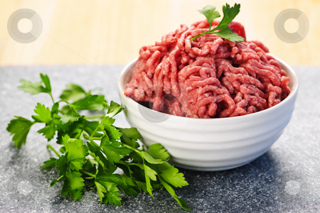 Bowl of raw ground meat stock photo, Close up on bowl of lean red raw ground meat by Elena Elisseeva