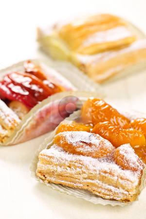 Pieces of fruit strudel stock photo, Closeup on slices of flaky fruit strudel desserts by Elena Elisseeva