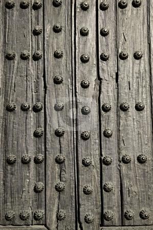 Door detail stock photo, Background of old wooden door with metal studs by Elena Elisseeva