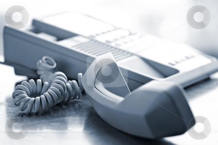 Desk telephone off hook stock photo, Telephone handset off the hook on desk by Elena Elisseeva