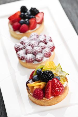 Fruit tarts stock photo, Closeup of fancy gourmet fresh fruit dessert tarts by Elena Elisseeva
