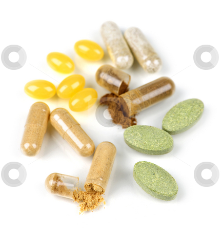 Herbal supplement pills stock photo, Mix of  herbal supplements and vitamin pills isolated on white by Elena Elisseeva