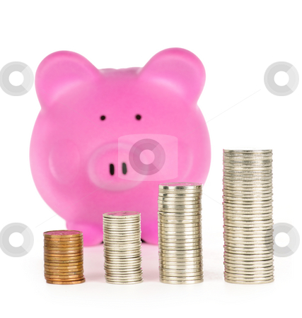 Piggy bank with coin stacks stock photo, Stacks of coins in front of pink piggy bank showing growth by Elena Elisseeva