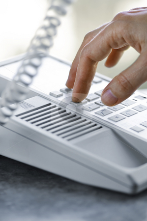 Dialing telephone stock photo, Close up of fingers dialing a desktop telephone by Elena Elisseeva