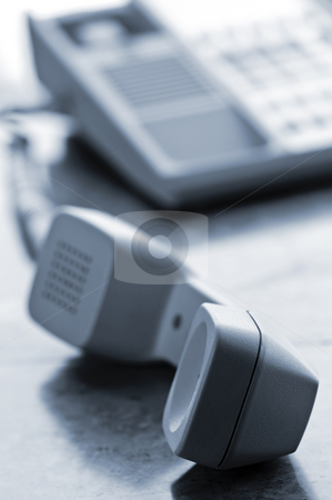 Desk telephone off hook stock photo, Telephone handset off the hook on desk by Elena Elisseeva