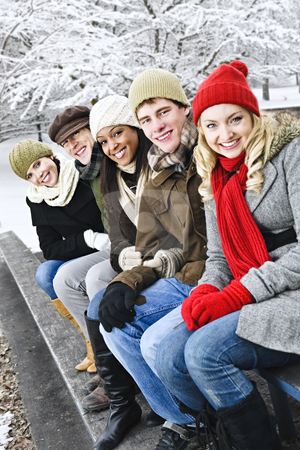 Group of friends outside in winter stock photo, Group of diverse young friends outdoors in winter by Elena Elisseeva